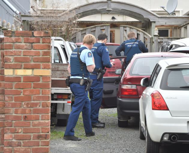 Armed police search a car in Clyde St, Dunedin, yesterday, part of a major national anti-methamphetamine operation. Photo: Gregor Richardson