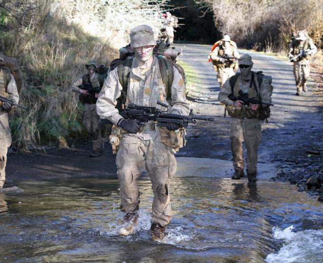 Private James McEwan, of Dunedin's Bravo Company 2/4 Royal New Zealand Infantry Regiment, crosses...