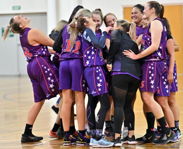 The South Pac Magic players celebrate their win over Ajax in the final of the Dunedin's women's club basketball competition at the Edgar Centre last night. Photo: Linda Robertson