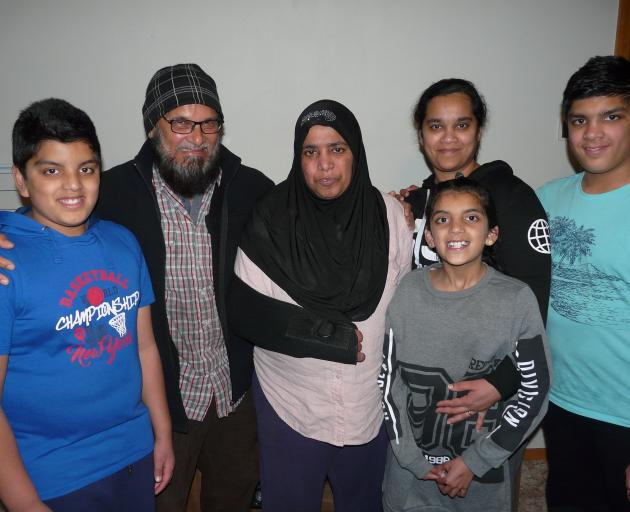 Pleased with the surprise news of her residency last night are Fijian settler Firoza Begum (centre) and her husband Mohammed Kalim, daughter Farina Shah and grandchildren Arsheed (12, left) and Farheel (9) and Aymaan (13) Shah, who live in Balclutha. Phot