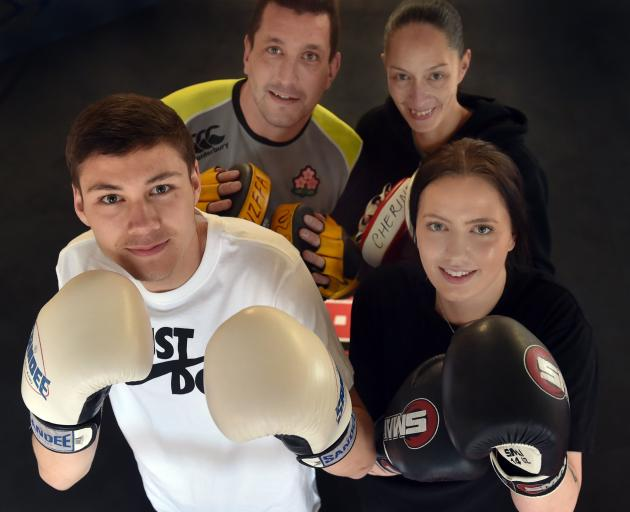 The Henry family sure packs a punch. Zsana (front right) and her brother Awatea (front left) will fight in the Canterbury Championships this weekend. Dad Ryan (back left) and mum Cherine are former South Island Golden Glove winners. Photo: Peter McIntosh