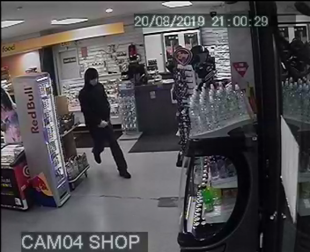 A man allegedly threatened a petrol station shop attendant with a knife before stealing cash yesterday. Photo: Supplied