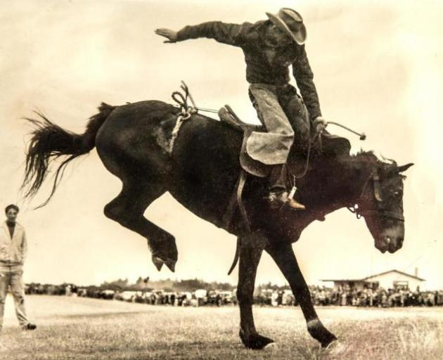 Brian Wilson rides a bucking horse during a rodeo in Rangiora in the 1950s. Photo: Supplied via Star.Kiwi
