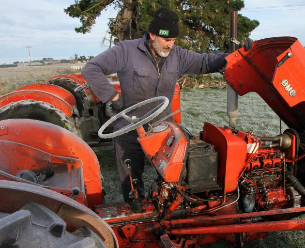 Well-known vintage machinery enthusiast Barry Allison looks over a BMC mini tractor, which has joined the line-up in the estate sale of longtime tractor collector, the late John Goldsworthy, of Milton. Photos: John Cosgrove