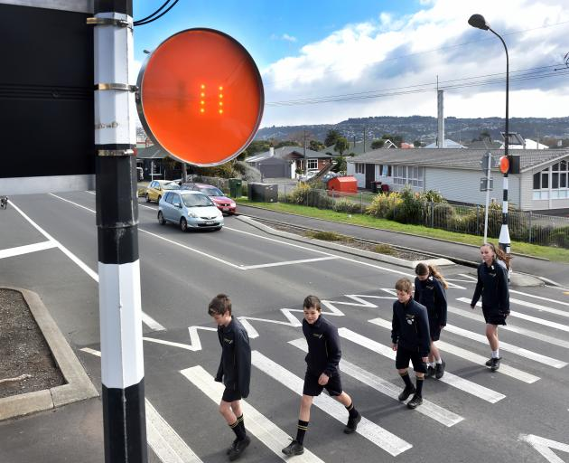 Tahuna Normal Intermediate pupils (from left) Regan Buchan (12), Max Stevenson (12), Alex McKeever (11), Isabella Inglis (12) and Aria Kerekere (13) cross Victoria Rd with help from a new device, created by Dunedin inventor Larry Burns, that alerts driver