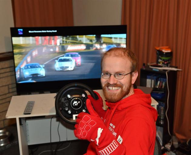 Champion Gran Turismo player Simon Bishop, at his racing console inside his Dunedin home. Photo: Linda Robertson