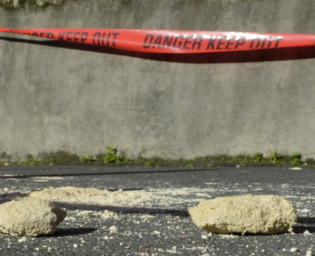 Part of the parapet of Hanover Hall lies on the footpath, likely after heavy rain on Sunday.