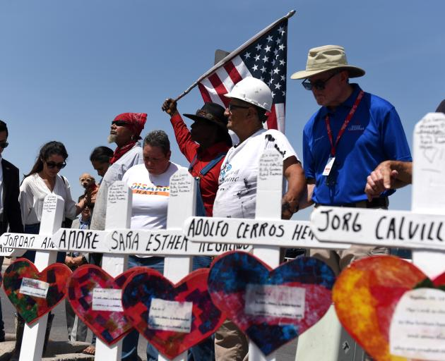 People pay their respects two days after a mass shooting in El Paso. Photo: Reuters
