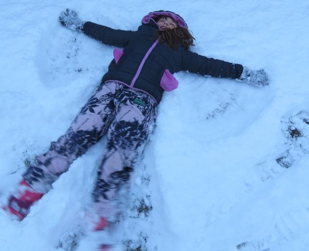 Isobel Rix (8), of Ettrick, was delighted when she woke up to snow as she and her family have...