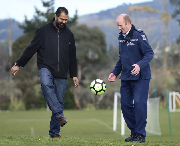 Otago Muslim Association president Dr Mohammed Rizwan (OMA United, left) kicks a ball around with...
