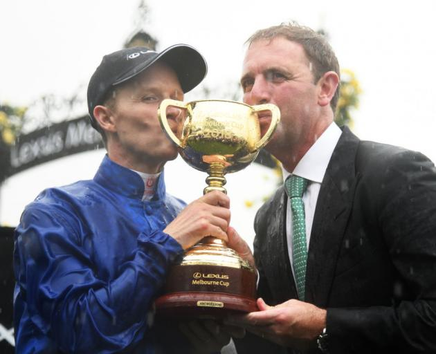 Rider Kerrin McEvoy and trainer Charlie Appleby pose with the cup after winning it with Cross Counter last year. Photo: Getty Images