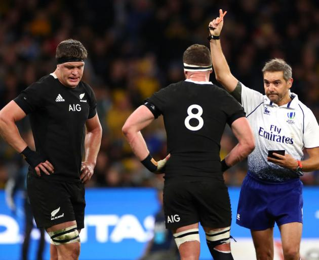 Scott Barrett (left) is shown the red card for dangerous play against Wallaby Michael Hooper....