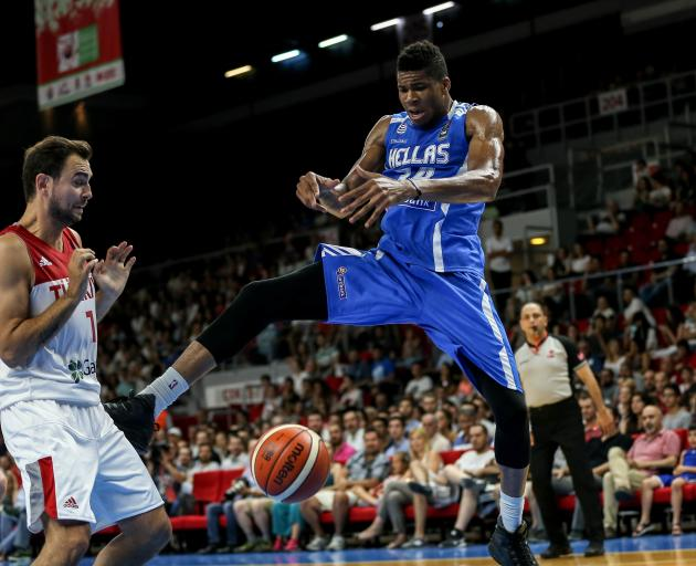 Giannis Antetokounmpo (right) in action for Greece in a recent warm-up game against Turkey. Photo...