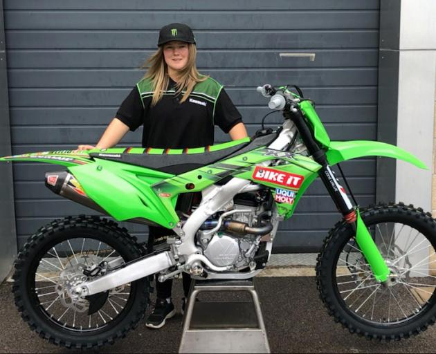 Dunedin motocross rider Courtney Duncan with the KX250 bike she will ride for her new team Bike It Dixon Racing Team in this year's women's world championship. Photo: Kawasaki Racing