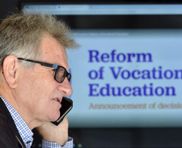 Otago Polytechnic chief executive Phil Ker takes a phone call after learning details of the...