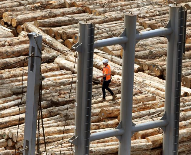 Logs are loaded at the Beach St wharf in Port Chalmers. Photo: Stephen Jaquiery