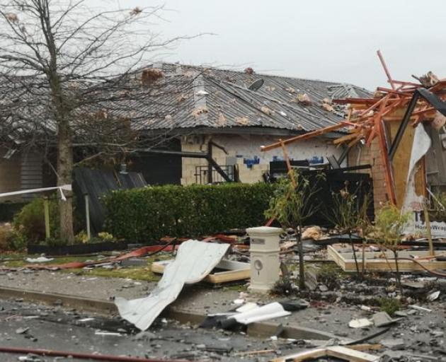 Several homes in Northwood, near the site of a gas explosion which completely destroyed a house, are likely uninhabitable. Photo: Logan Church/RNZ