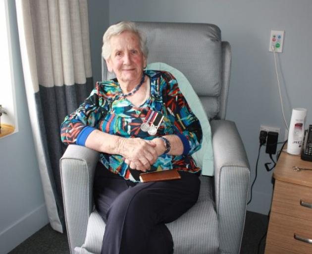 Nettie Glass wears the medals she was awarded for her service during World War 2.  Photo: Gus...