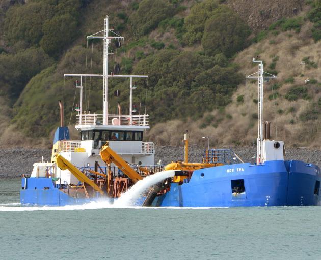 The Port Otago dredge New Era works in Otago Harbour. Photo: ODT files