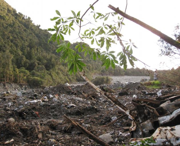Part of what remains of the old Fox Glacier township landfill, which has been shored up on the...