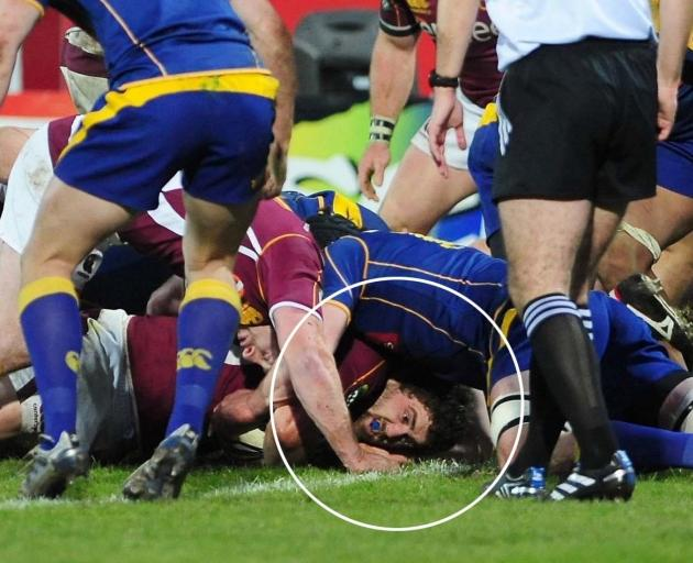 Southland captain Jamie Mackintosh (circled) is about to be awarded the only try of the game. Photo: Craig Baxter