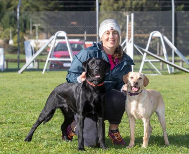 Erin Moyle, with Marco, left, who failed as a police dog, and Poppy, who is currently in training...