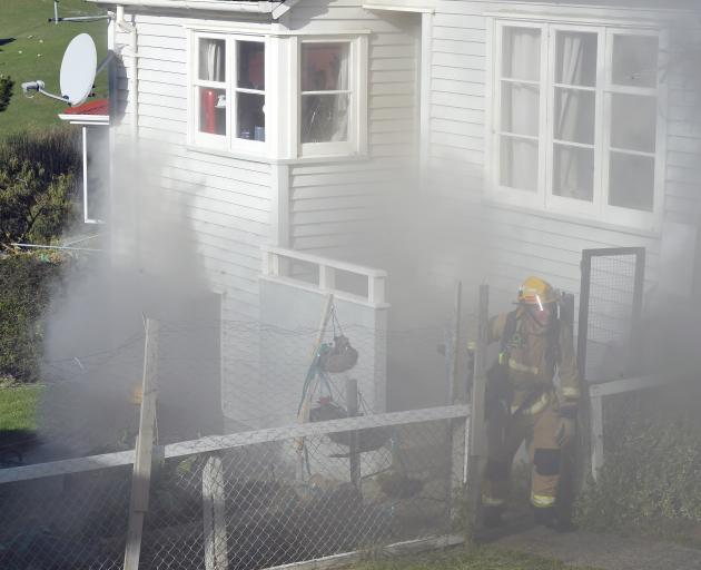 Dunedin firefighters battle a blaze on Puketai St. Photo: Gregor Richardson