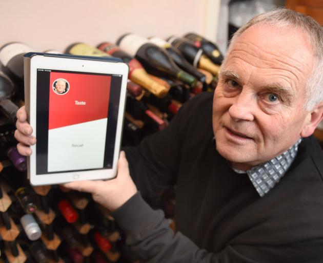 Ricky Collins displays the Wine inMind app which he has co-founded.PHOTO: GREGOR RICHARDSON