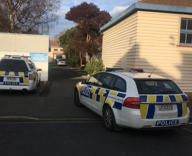 Police outside the Dunedin School of Art. Photo: George Block