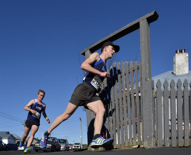 Janus Staufenberg keeps close to the fence line as he turns from Plunket St into Richardson St...