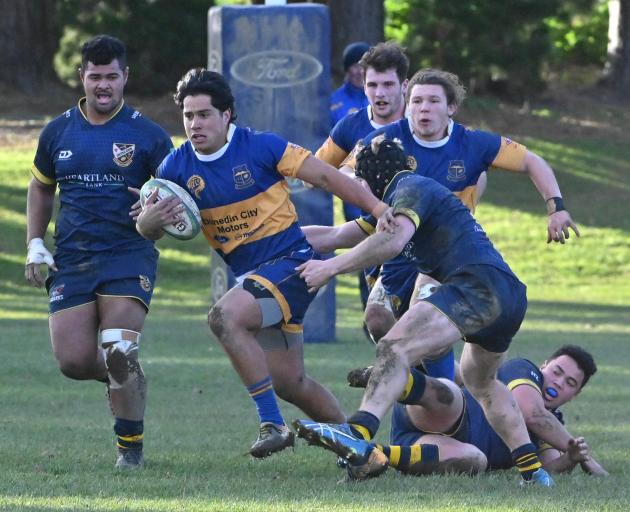 Taieri centre William Ngatai looks to break through the Dunedin defence at Peter Johnstone Park...