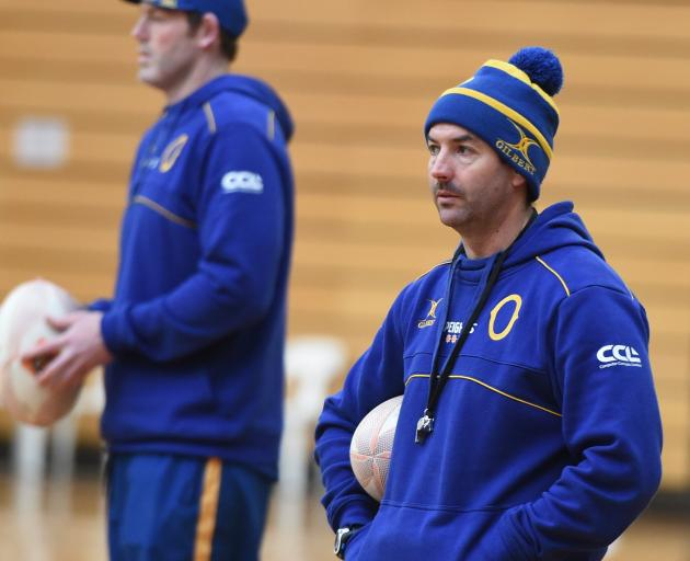 Otago attack coach Ryan Martin (right) casts his eye at training at the Edgar Centre earlier this...
