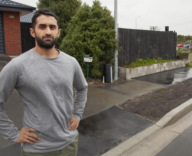 Sirwan Khalandi outside his Scruttons Rd house which he says has been damaged by roadworks. Photo: Geoff Sloan