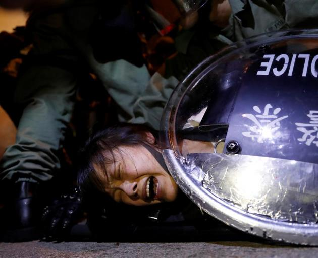 Hong Kong Police clash with protesters in the city. Photo: Reuters