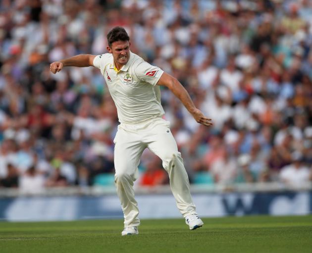 Australia's Mitchell Marsh celebrates taking the wicket of England's Sam Curran. Photo: Reuters