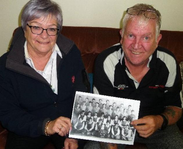 Methven High School class of 1969 students Judith Lilley and Kit Kennedy with a copy of the old class photo