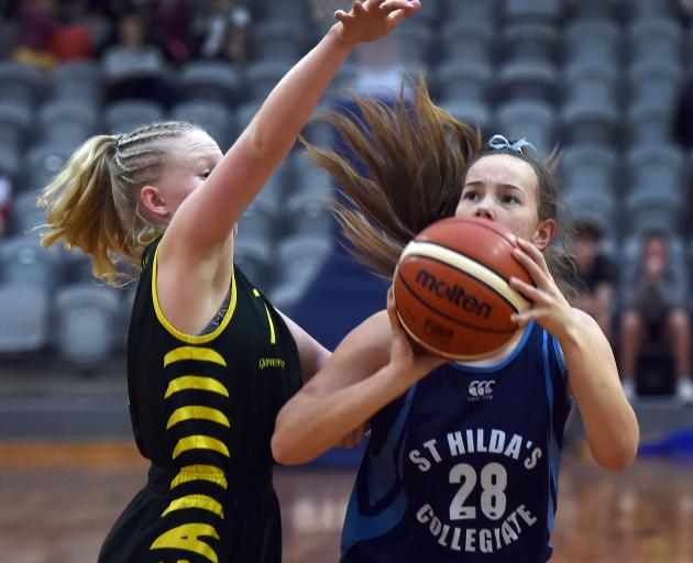 Chloe Edwards, of Waimea College (left), challenges as Jaymee Meffan, of St Hilda's, looks to shoot during the final of the South Island secondary schools junior basketball championships at the Edgar Centre yesterday. St Hilda's Collegiate was edged 59-54