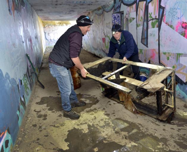 Otago Peninsula Community Board chairman Paul Pope (left) and board member Graham McArthur clean...