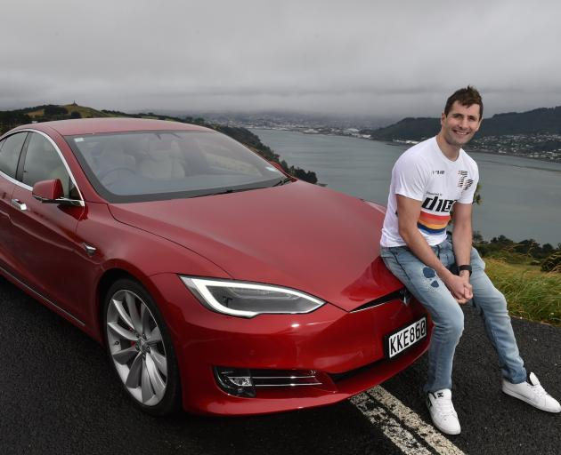 Virtual games and real cars. Dean Hall with his Tesla in 2017. PHOTO: GREGOR RICHARDSON