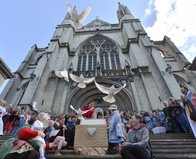 Doves fly from St Paul's Cathedral, Dunedin, after a special service yesterday to mark the 150th...
