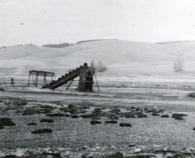 The old goldmining dredge, photographed in 1957, after the town had been flooded.