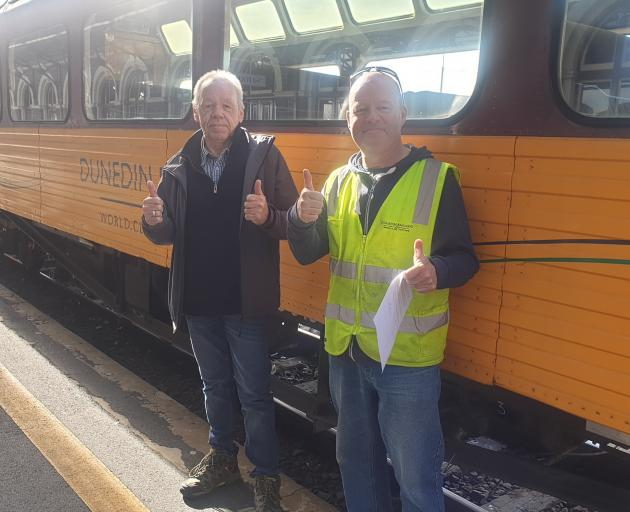 Rail and Maritime Union delegate Julian Evans (left) with train assistant Paul Jeffrey, whose hourly wage has just increased from $17.70 to $21.15 after 30-years service with the railway. PHOTO: RMTU