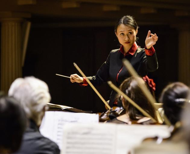 Tianyi Lu in action conducting the Bristol Metropolitan Orchestra. Photo: Adrian Malloch Photography