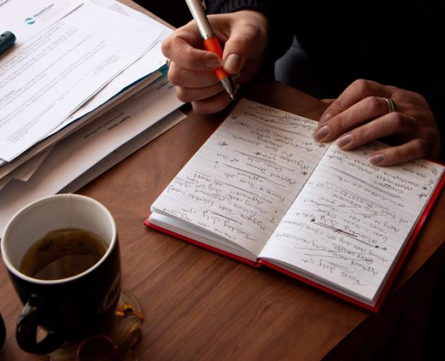 Teresa Gooch keeps track of the dozens of jobs she's applied for in a notebook - crossing out the entries when she doesn't hear back, or misses out. Photo: RNZ / Kate Newton