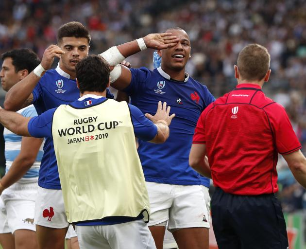 France's Gael Fickou celebrates scoring their first try. Photo: Reuters