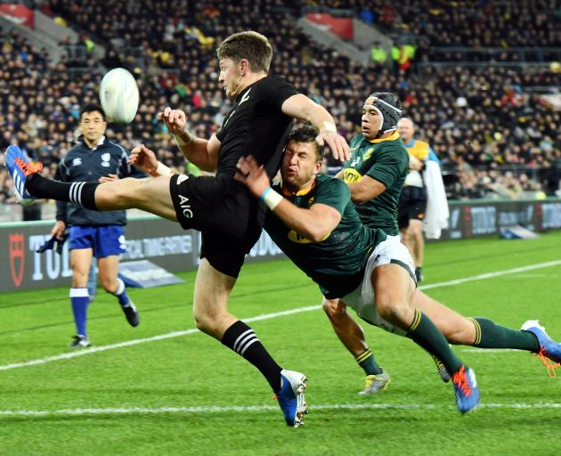 Handre Pollard tackles Beauden Barrett as he attempts to clear the ball. Photo: Getty Images
