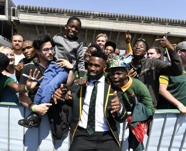 Springbok captain Siya Kolisi poses with fans during his side's official send-off in Johannesburg...