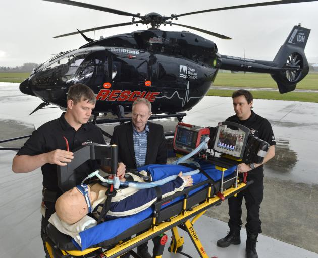 Otago Rescue Helicopter Trust paramedics Pete Walker-Nell (left) and Ryan Burgess (right) test the trust's new ICU gear with Otago Motor Club Trust member Mark Laughton in Mosgiel. Photo: Gerard O'Brien