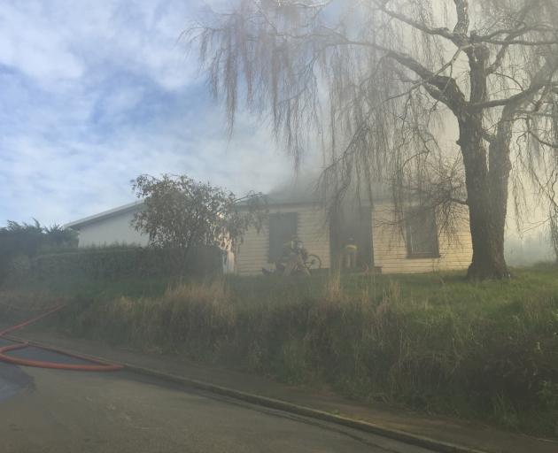 Firefighters are battling a blaze on Rockside Rd. Photo: Gregor Richardson