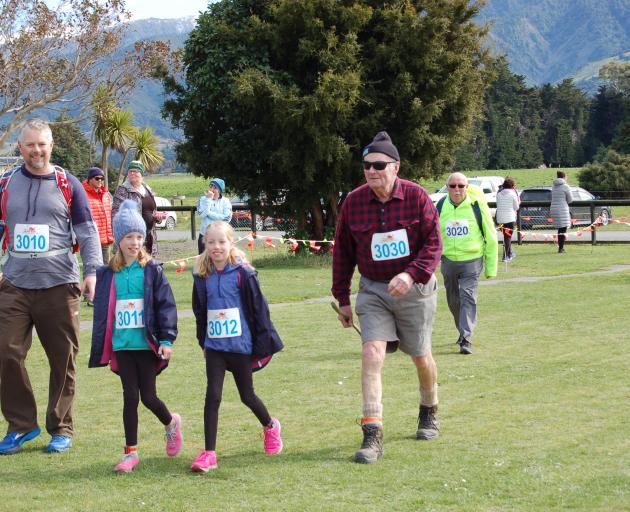 Entrants in Kaikoura Suburban School's Whale Run included Richard South, left, Cameron South, Holly South and Alastair Campbell completing the 10km walk. Alastair was the oldest competitor, at 84. Photo: Supplied